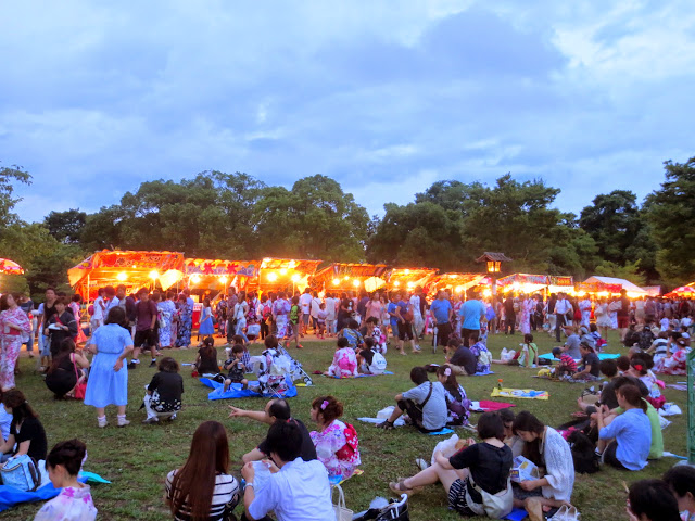 The food stalls and festival-goers at the Ohori Fireworks Festival