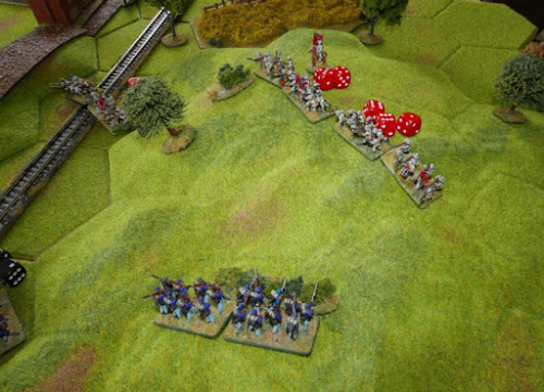 The Confederate hold on the hill weakens