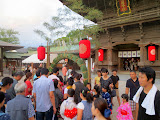 People walking through the festival gate 3 times at Hakozaki shrine for luck (looping to the left, to the right, and then left again)
