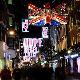 Distant Peace by DJ Cockburn - Public Holidays Christmas ( festive season, soho, carnaby street, urban decay, joy, christmas, love, lights, kiss, england, pedestrian, london, shops, crossroad, buildings, night, decorations, shopping, union flag, union jack, hope, retail )