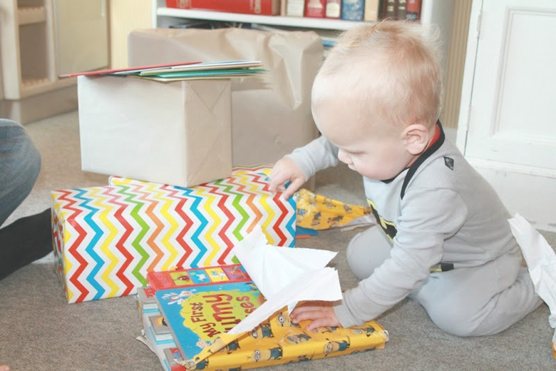 baby-tearing-wrapping-paper-off-gift