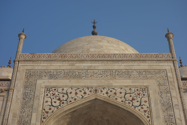 Islamic inscriptions, precious inlay stones, and complex patters adorn the Taj Mahal.