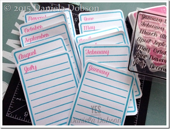 Stamped tags by Daniela Dobson