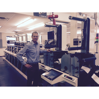 President and founder, Tom Cummings, In front of his new Nilpeter FB-3 flexo press.
