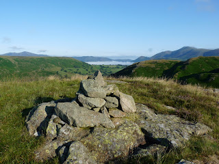 Bassenthwaite in the far distance under the mist from another cairn on the top of High Rigg.