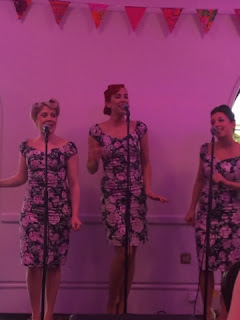 vintage dressed singing group
