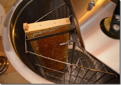 frame of honey in extractor