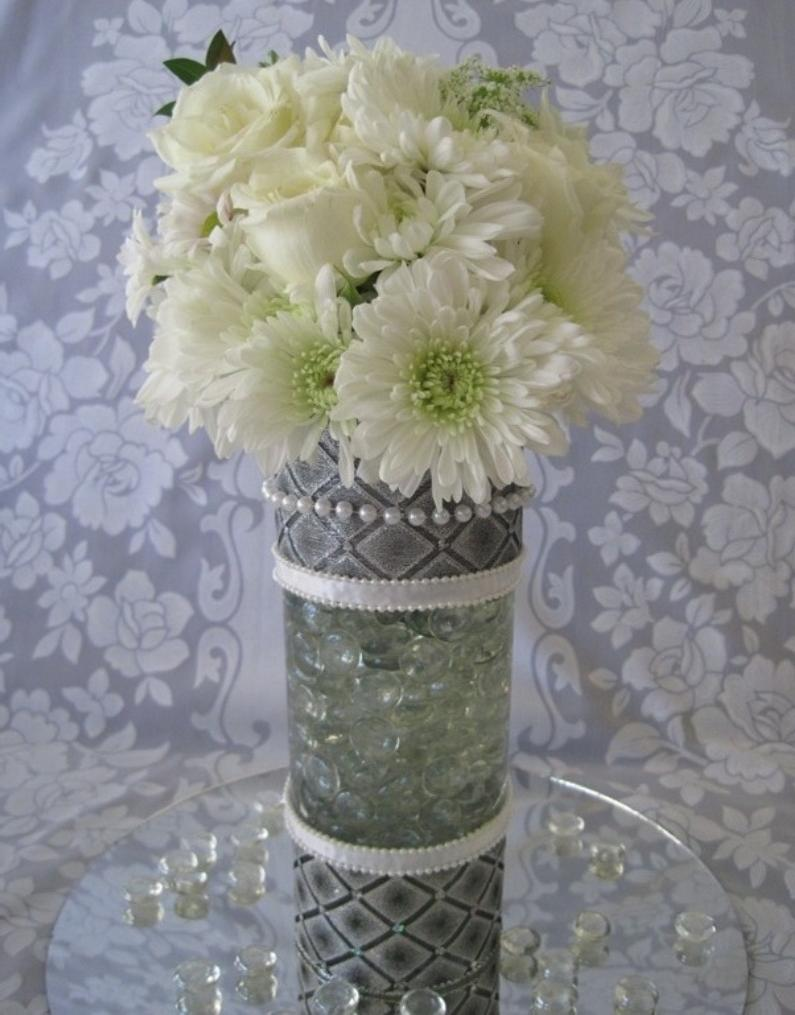 Place wet foam in vase,