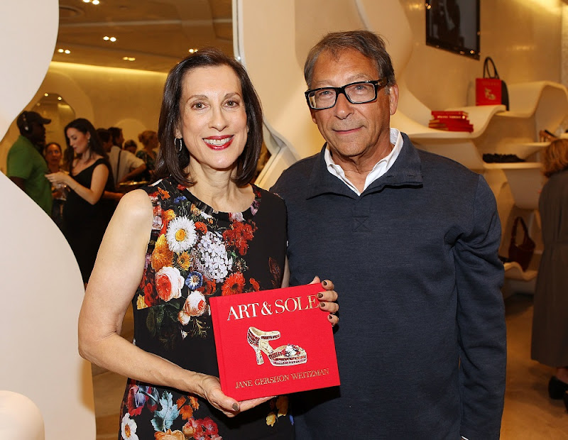 "NEW YORK, NY - SEPTEMBER 10:  Author Jane Weitzman and designer Stuart Weitzman pose for a photo at the ""Art & Sole"" by Jane Weitzman book launch at the Stuart Weitzman Boutique on September 10, 2013 in New York City.  (Photo by Paul Morigi/Getty Images for Stuart Weitzman)"