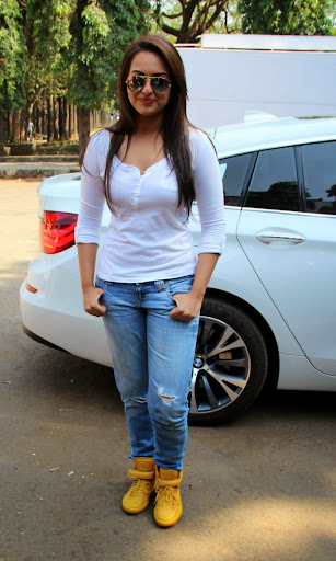 Sonakshi Sinha in White Top and Blue Jeans Photos With Yellow Color Shoes