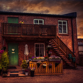 Storm coming by Geir Blom - City,  Street & Park  Night ( old house, sky, night photography, sunset, weather, bricks, flowers )