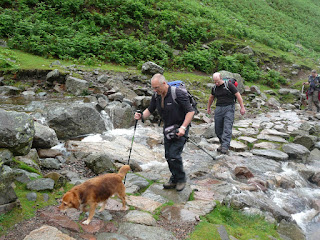 David Hall and Richard crossing one of the streams. Polly leads the way.