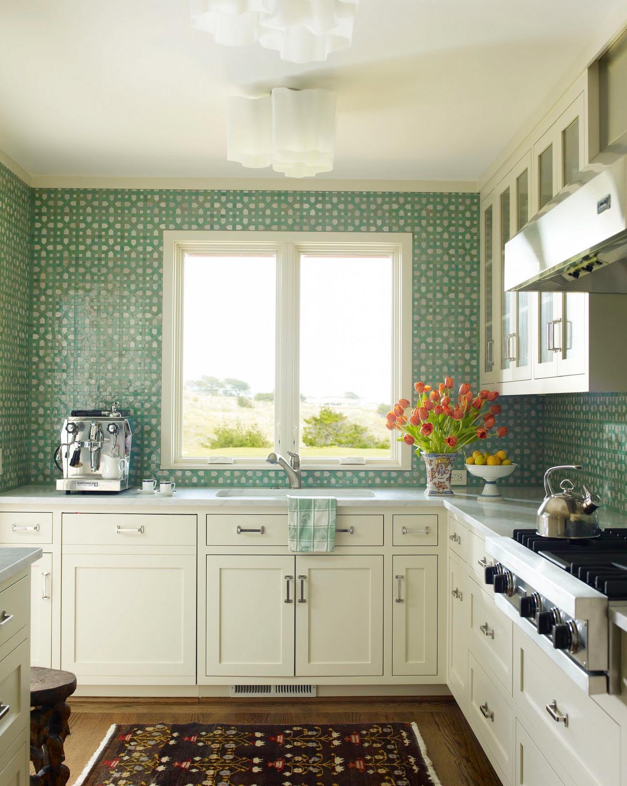 Aqua mosaic tiles form a