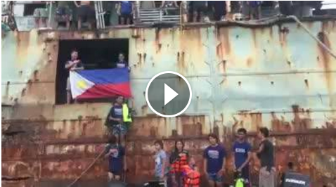 Image of Soldier Protecting Ayungin Shoal Sings Philippine National Anthem in Rusty Ship