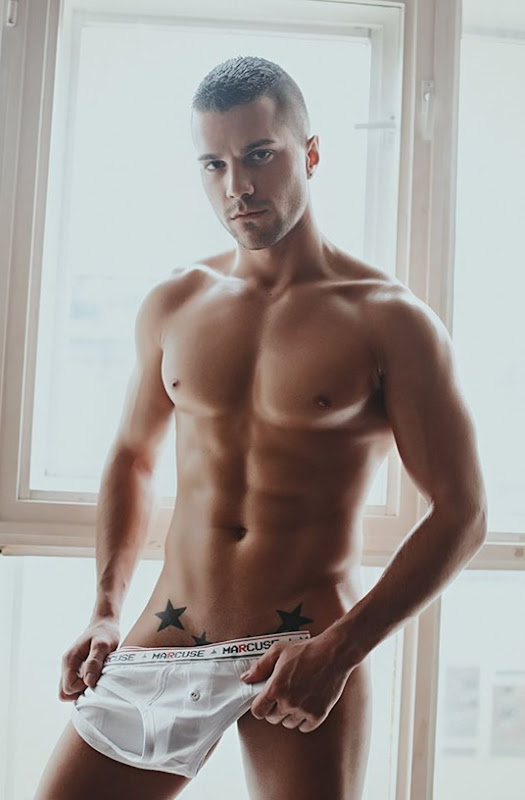 Tim Holding A Marcuse White Brief