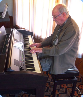George Watt playing the Club's Clavinova CVP-509 for the Arrival Music