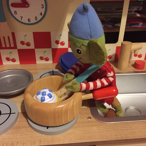 elf on the shelf frying cupcakes
