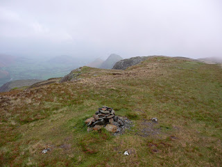 Maiden Moor summit with Catbells in the distance.