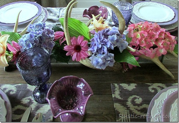 Tablescape using rustic elements. A chicken feeder as a centerpiece