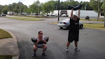 """""""The Litter Box"""" - AMRAP in 20 of 10 sandbag cleans, front squats, push presses, and a 25m sandbag carry."""