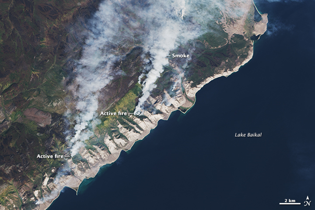 The Operational Land Imager on Landsat 8 captured this natural-color image of a few fires still lingering around the western shore of Lake Baikal on 13 September 2015. Note the charred, blackened vegetation (burn scar) west of the largest smoke plume. Photo: Joshua Stevens /  U.S. Geological Survey
