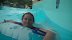 Happy Heather in the wave pool.