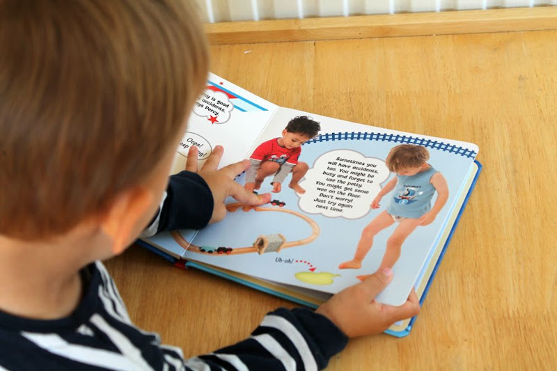toddler-pointing-to-trains-in-a-book