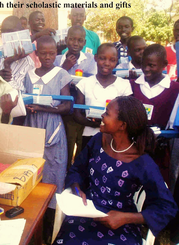 Children_of_hope_with_their_scholastic_materials_and_gifts[1] - Copy