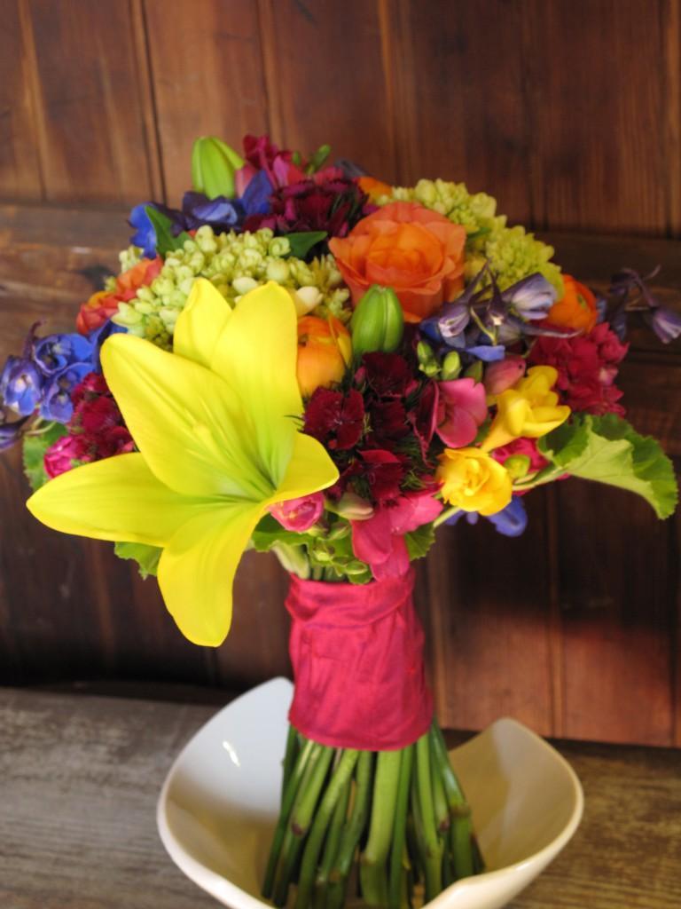 orange ranunculus, roses,