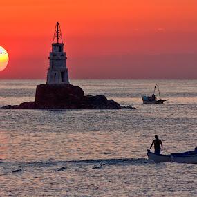 Sunrise at Ahtopol lighthouse by Anton Donev - Landscapes Sunsets & Sunrises ( red sky, hdr, lighthouse, sea, boat, sun, sky, red, ahtopol, horizontal, sunrise, fisherman, landscapes )