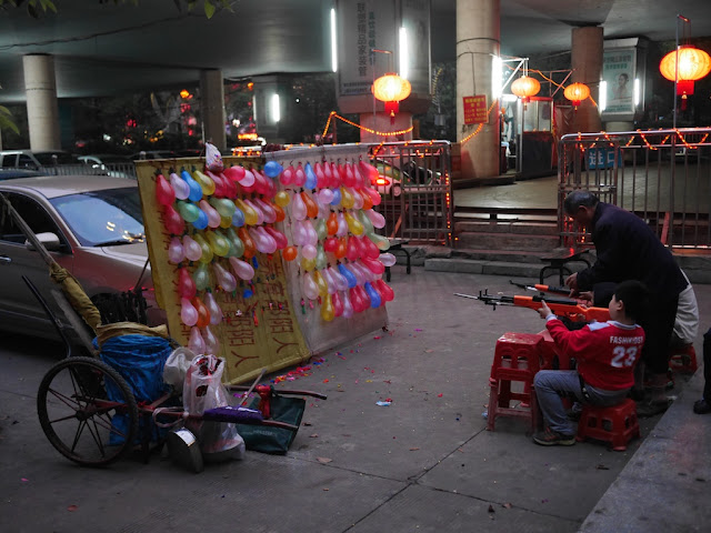boy shooting balloons in Shaoyang