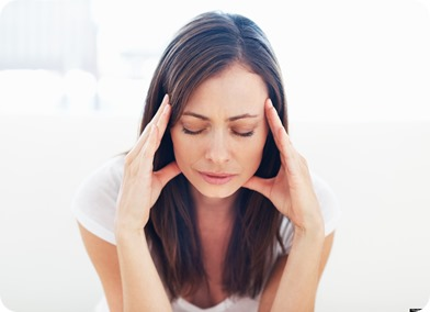 Portrait of stressed woman having head pain; Shutterstock ID 80165410; PO: The Huffington Post; Job: The Huffington Post; Client: The Huffington Post; Other: The Huffington Post