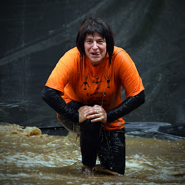 No No, It's Not Finished Yet ! by Marco Bertamé - Sports & Fitness Other Sports ( water, muddy, orange, differdange, strong, 2015, woman, lady, brown, soup, kneeling, strongmanrun, luxembourg )