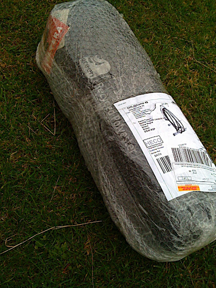 The tent arrives by courier, from greenoutdoors.co.uk - its a small package for a tent.