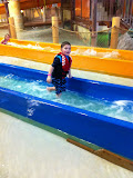 Logan Vojtko and Hannah going down a water slide at Kalahari in OH 02182012c