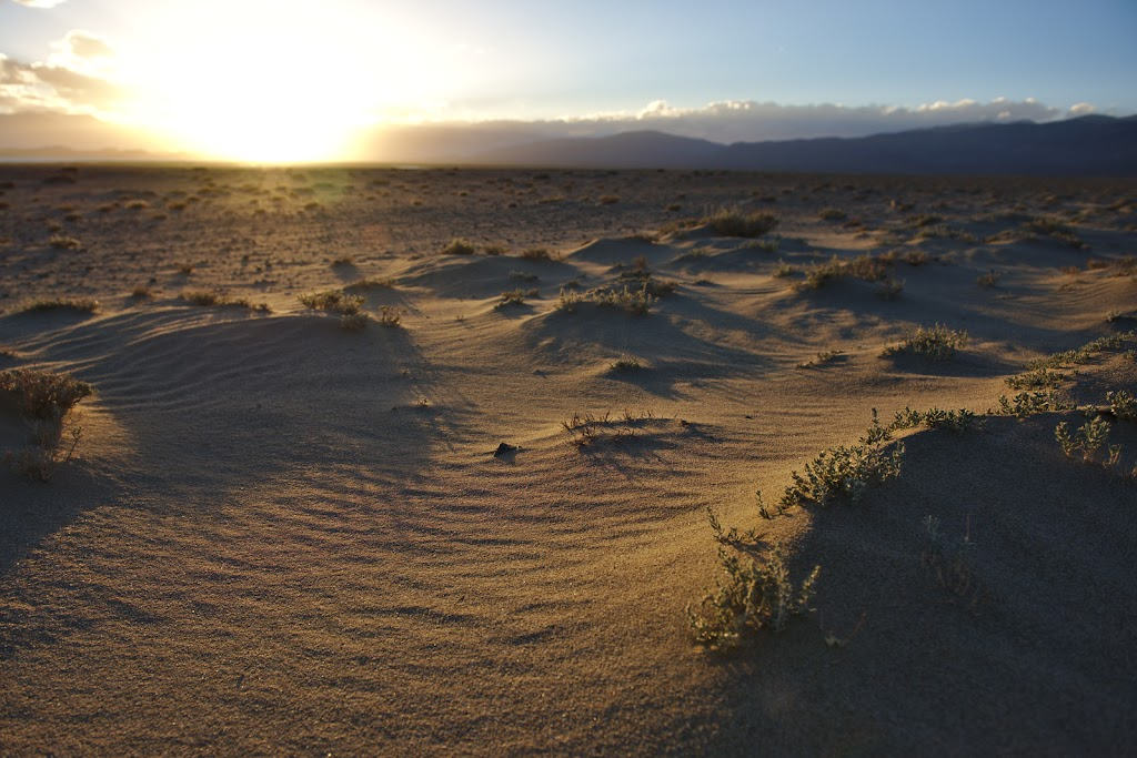 Small sand-dunes across the Pamir plateau in the soft light of the sunset.