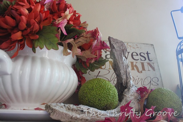 A thrifty autumn side table decked out with thrift store finds, things around the house and freebies from mother nature