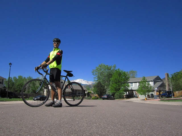 Kitted up for a chilly morning ride on Sue with a snow-capped Pikes Peak in the background
