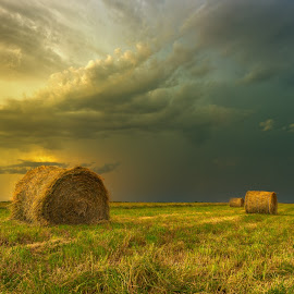 Prairie Storm by Stuart Deacon - Landscapes Prairies, Meadows & Fields ( green, storm, manitoba, yellow, clouds, brown, prairie, summer, haybails, canada, blue, field, winnipeg, grass, hdr, landscape )