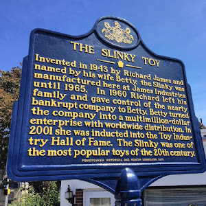 This historic marker memorializes the first manufacturing site of the Slinky, one of the top selling toys of the 20th Century, in Clifton Heights, Pennsylvania. Slinky was invented by mechanical ...