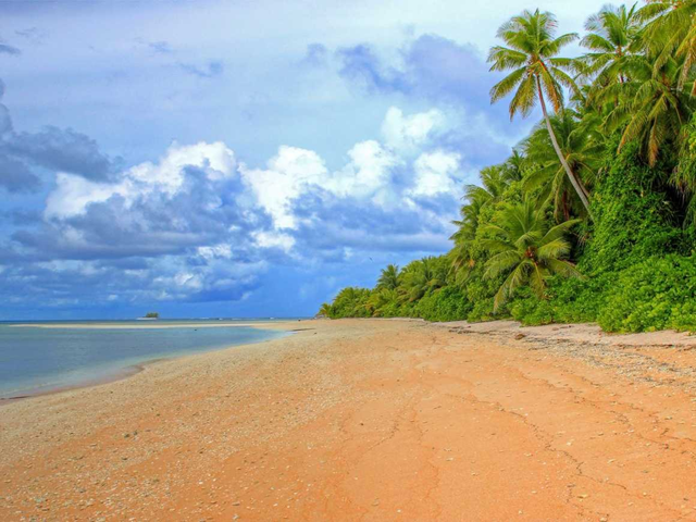 A beach on the island nation of Tuvalu. This Polynesian island nation, located between Hawaii and Australia, may be a tropical paradise, but it risks becoming submerged by rising seas as a warming climate melts ice sheets and causes water to expand. Photo: Nick Hobgood / Flickr