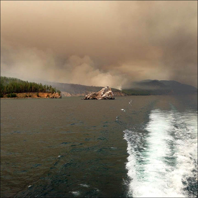 Smoke from forest fires rises over Lake Baikal, Siberia, on 10 August 2015. Photo: Sasha Chernykh / The Siberian Times