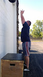 Jonathan doing battle with wallballs... this workout was a killer for everyone!