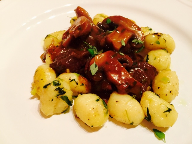 Red wine marinated venison with mushrooms and gnocchi