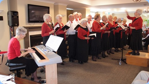 the Evelyn Page Village Choir with choir master, Julia Bissett and pianist Patricia. Photo courtesy of Dennis Lyons.