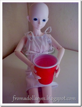 Bjd holding a plastic cup