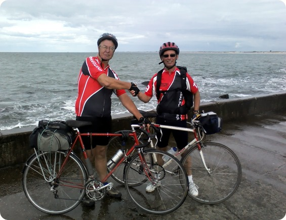 Riding the River Rhine – l-r – Ben and Jim arrive at  the North Sea