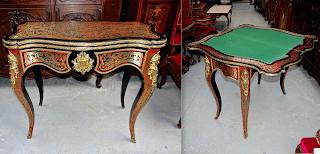 Ломберный стол в стиле Буль. 19-й век. Латунная инкрустация, позолоченная бронза, сукно. 93/46/79 см. 4000 евро.