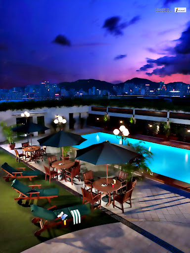 pool-sweet-wood-patio-chairs-and-green-umbrella-and-magnificent-blue-pool-in-top-building-rooftop-swimming-pools.jpg