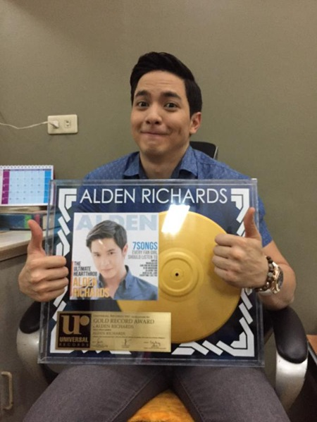 Alden Richards and his gold record award